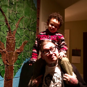 Patt Whelan gives his buddy, Kyler, a boost to see the tree!